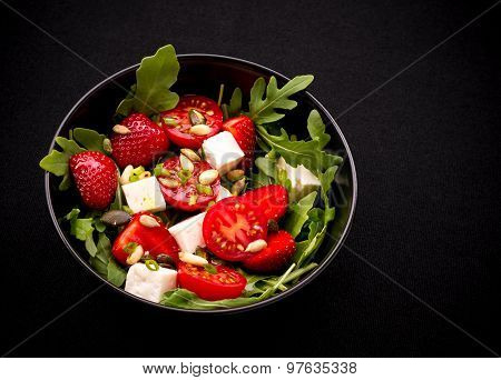 Strawberry Tomato Salad With Feta Cheese, Olive Oil On Black