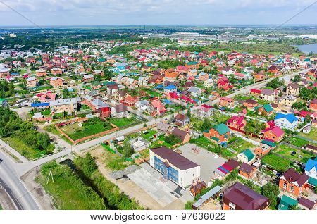 Aerial view of houses on housing estates. Tyumen