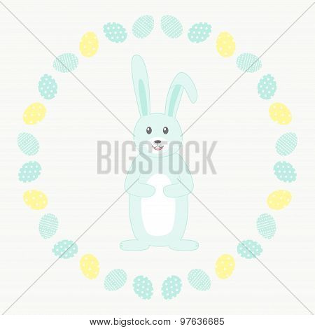 Light blue rabbit in the circle of easter eggs