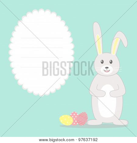 Easter greeting card with rabbit, eggs and frame