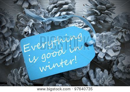 Light Blue Label On Fir Cones Quote Everything Good Winter
