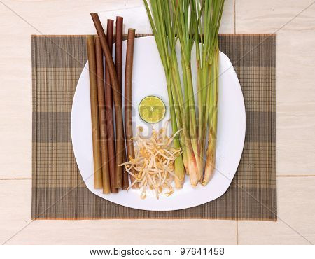 Fresh Vegetables And Herbs On White Plate