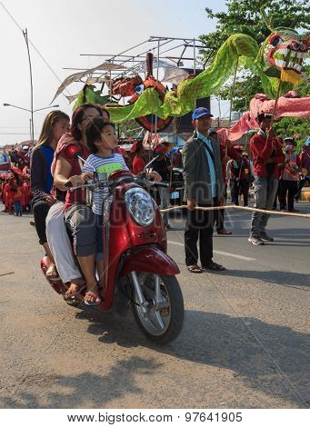 Casual Family Pass By The Procession Of Sihanoukville Annual Carnival