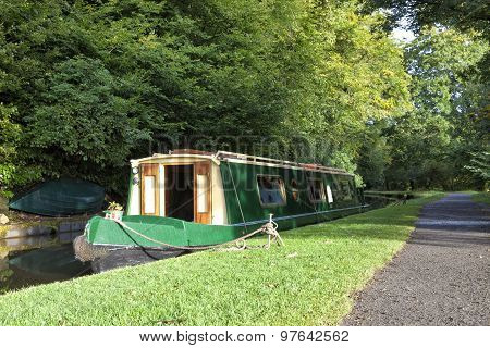 Narrow canal boat moored at canal towpath in Brecon Beacons Wales England