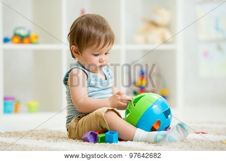 kid lying on soft carpet in children room