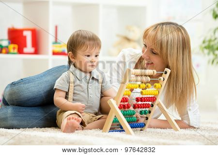 kid toddler playing with abacus