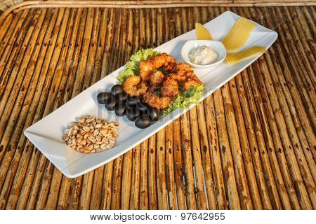 Squid Tempura Snack On Plate On Bamboo Table