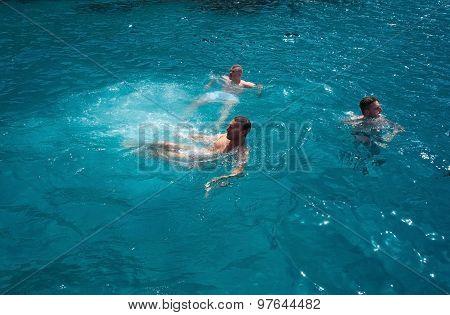 People splash and swim