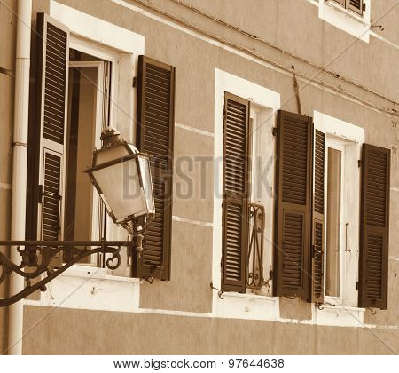 Italy. Cinque Terre. Riomaggiore Village. Lantern On The Wall. In Sepia Toned. Retro Style