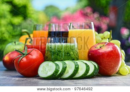 Glasses With Fresh Organic Detox Juices In The Garden