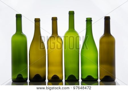 Empty bottles of wine on white background