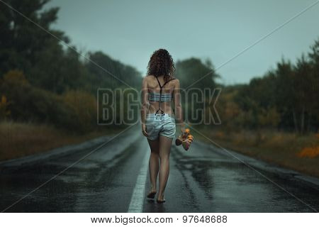 Girl Back. Walks On The Road. Under Rain.
