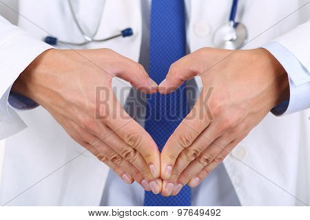 Male Medicine Doctor Hands Showing Heart Shape