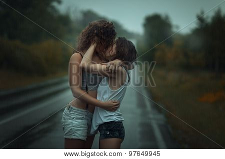 Girls Standing In The Rain On Street.