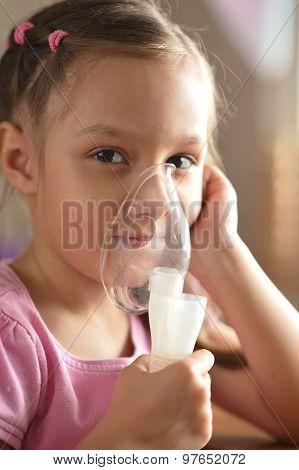 Lovely little girl with inhaler