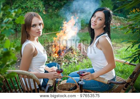 Girls With Red Wine Glasses Near Bonfire
