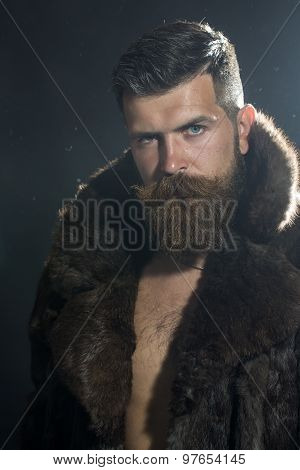 Sullen Man In Fur Coat