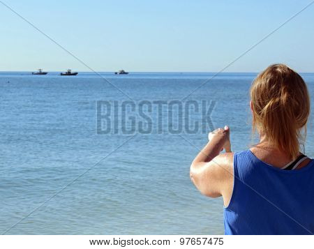Woman Pointing to Ships at Sea
