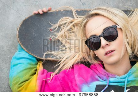 Pretty blond girl with skateboard