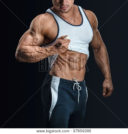 Handsome Bodybuilder With With Great Physique Shows His Six Pack