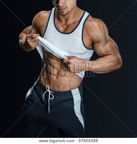 Athletic Male Model Posing, Pulling Up Tank Top