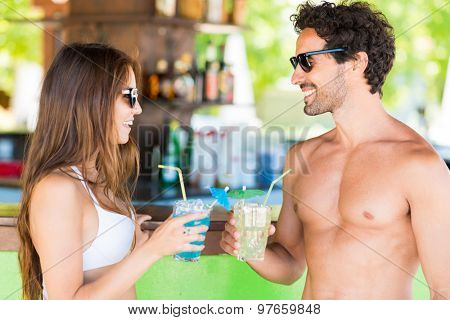 Beautiful young people talking in a beach bar