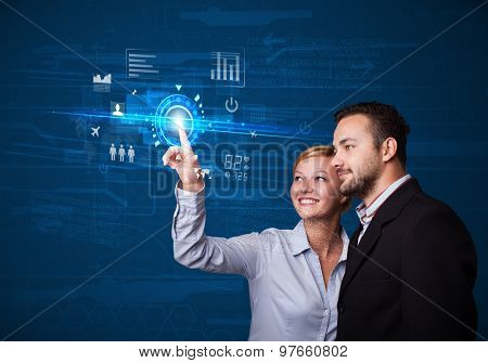 Business couple touching future web technology buttons and icons