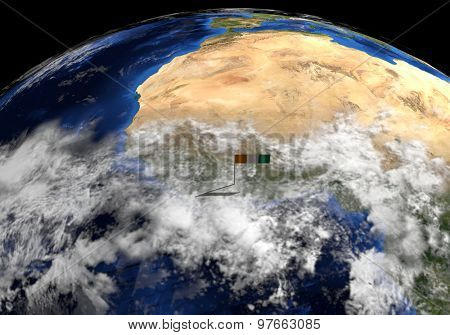 Ivory Coast flag on pole on earth globe illustration - Elements of this image furnished by NASA