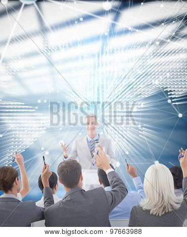 Business people raising their arms during meeting against glowing world map on black background