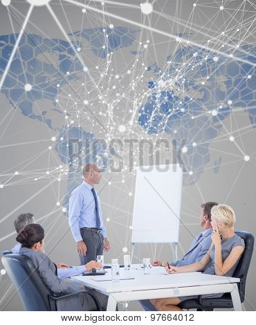 Business people listening during meeting against background with world map