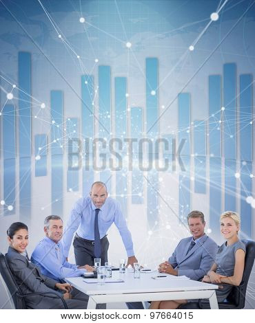 Happy business people looking at camera against global business graphic in blue