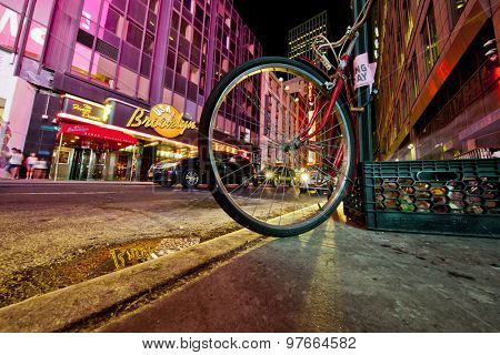 NEW YORK, NY, USA - June 12, 2015: Low angle of New York's busy 42nd Street off Times Square showing a bike and the Brooklyn Diner