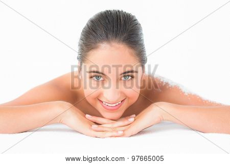 Portrait of a beautiful brunette enjoying a salt scrub treatment at the health spa