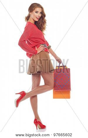 woman with shopping bags. Studio shoot