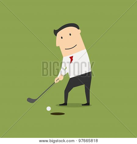 Businessman putting ball into a hole