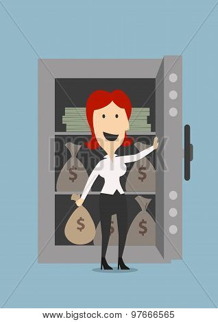 Businesswoman opens a safe with money