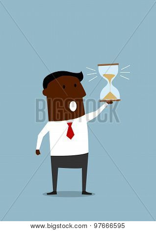 Black businessman with hourglass in hand