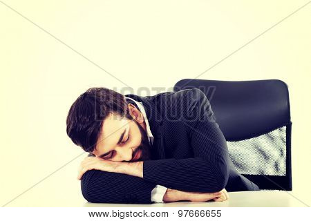 Tired businessman resting at the desk.
