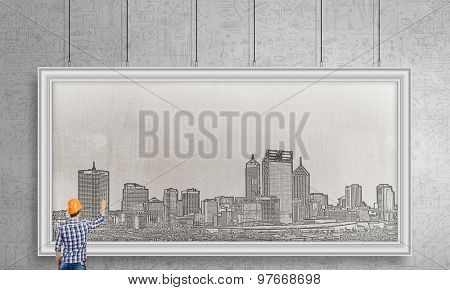 Rear view of businessman drawing business plan on white banner