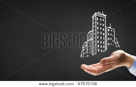 Close up of hand and drawn building model in palm
