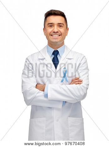 healthcare, profession, people and medicine concept - smiling male doctor in white coat with sky blue prostate cancer awareness ribbon