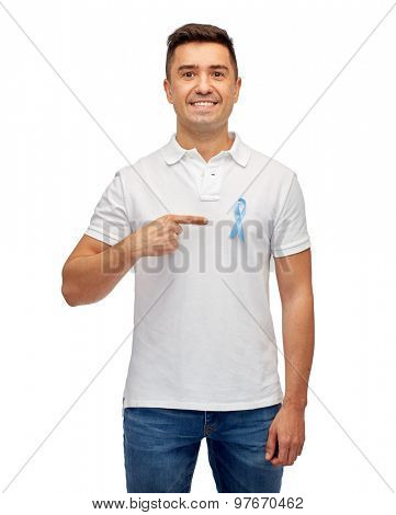 medicine, health care, gesture and people concept - smiling middle aged latin man in t-shirt with blue prostate cancer awareness ribbon pointing finger on himself