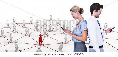 Business people using smartphone back to back against human figures with connecting lines