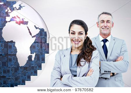Portrait of happy business people standing together against grey background