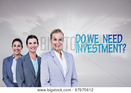 Smiling young businesswomen in a line against glowing world map on black background