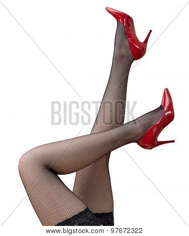 Sexy Female Legs In Black Tights And Red Shoes Raised Up.