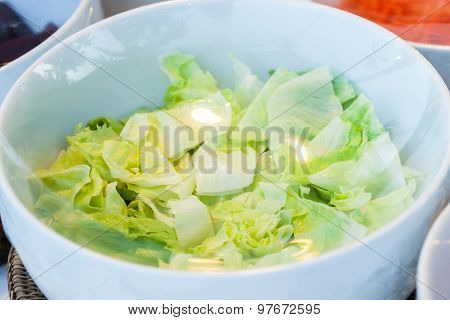 Vegetables In A Glass Bowl On The Plastic Wrap.