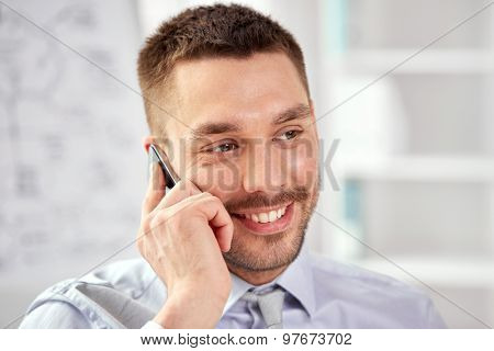 business, technology and communication concept - young smiling businessman calling on smartphone