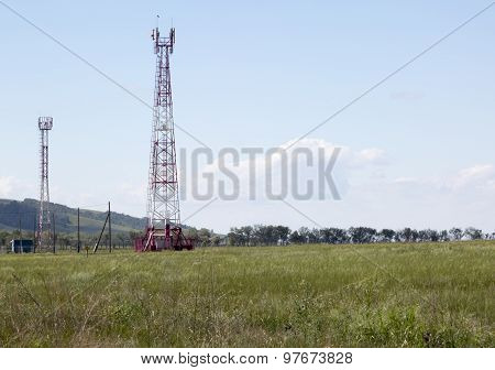 Cellular tower in sunny summer day