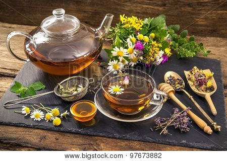 Cup of herbal tea with honey